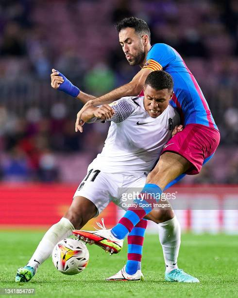 Sergio Busquets of FC Barcelona competes for the ball with Darwin Machis of Granada CF during the La Liga Santander match between FC Barcelona and...