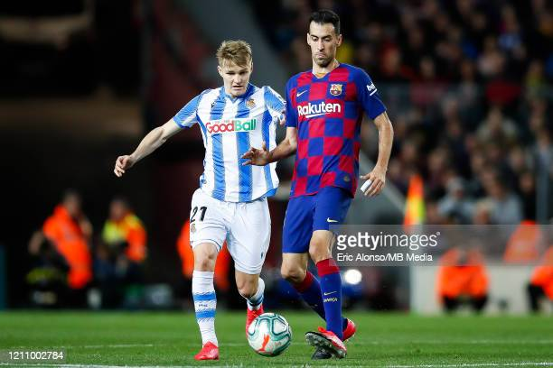 Sergio Busquets of FC Barcelona competes for the ball with Martin Odegaard of Real Sociedad during the Liga match between FC Barcelona and Real...