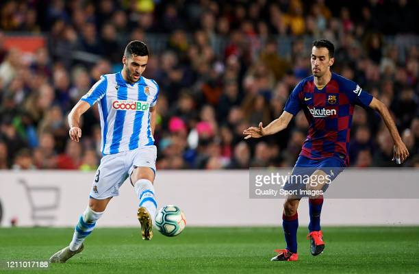 Sergio Busquets of FC Barcelona competes for the ball with Mikel Merino of Real Sociedad during the Liga match between FC Barcelona and Real Sociedad...