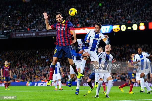 Sergio Busquets of FC Barcelona duels for a high ball with Sergio Garcia of RCD Espanyol during the La Liga match between FC Barcelona and RCD...