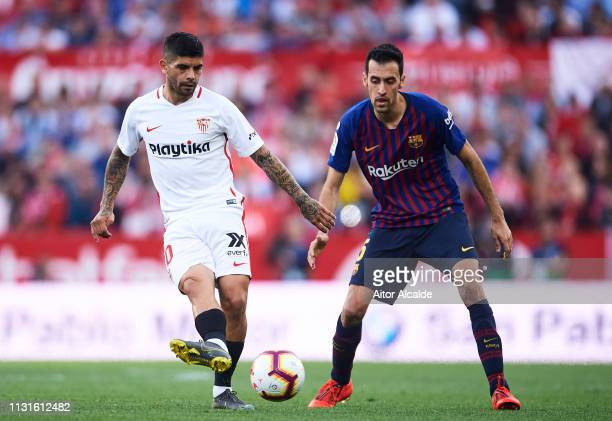 Sergio Busquets of FC Barcelona duels for the ball with Ever Banega of Sevilla FC during the La Liga match between Sevilla FC and FC Barcelona at...
