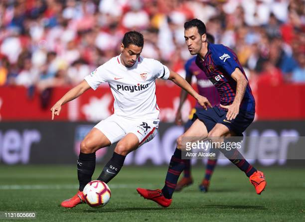 Sergio Busquets of FC Barcelona duels for the ball with Wissam Ben Yedder of Sevilla FC during the La Liga match between Sevilla FC and FC Barcelona...