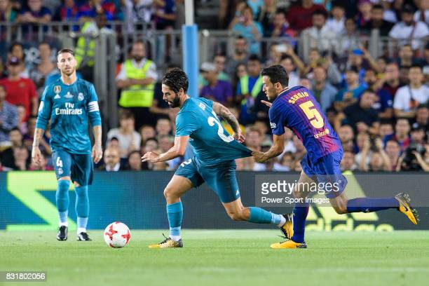 Sergio Busquets of FC Barcelona fights for the ball with Isco Alarcon of Real Madrid during the Supercopa de Espana Final 1st Leg match between FC...