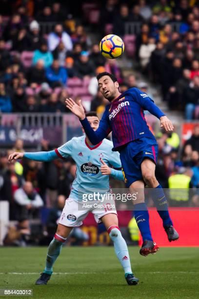 Sergio Busquets of FC Barcelona heads the ball next to Iago Aspas of Celta de Vigo during the La Liga match between FC Barcelona and Celta de Vigo at...