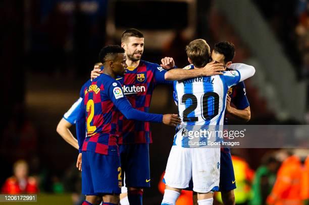 Sergio Busquets of FC Barcelona hugs Nacho Monreal of Real Sociedad during the Liga match between FC Barcelona and Real Sociedad at Camp Nou on March...