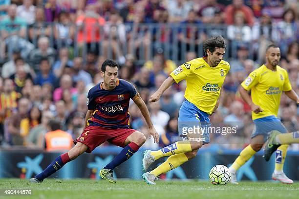 Sergio Busquets of FC Barcelona Juan Carlos Valeron of Las Palmas during the Primera Division match between FC Barcelona and Las Palmas on September...
