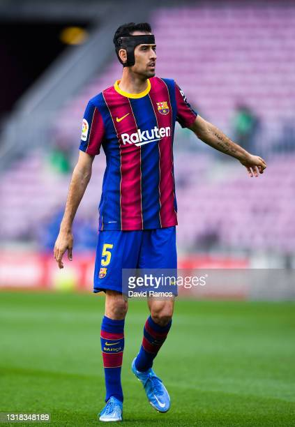 Sergio Busquets of FC Barcelona looks on during the La Liga Santander match between FC Barcelona and RC Celta at Camp Nou on May 16, 2021 in...