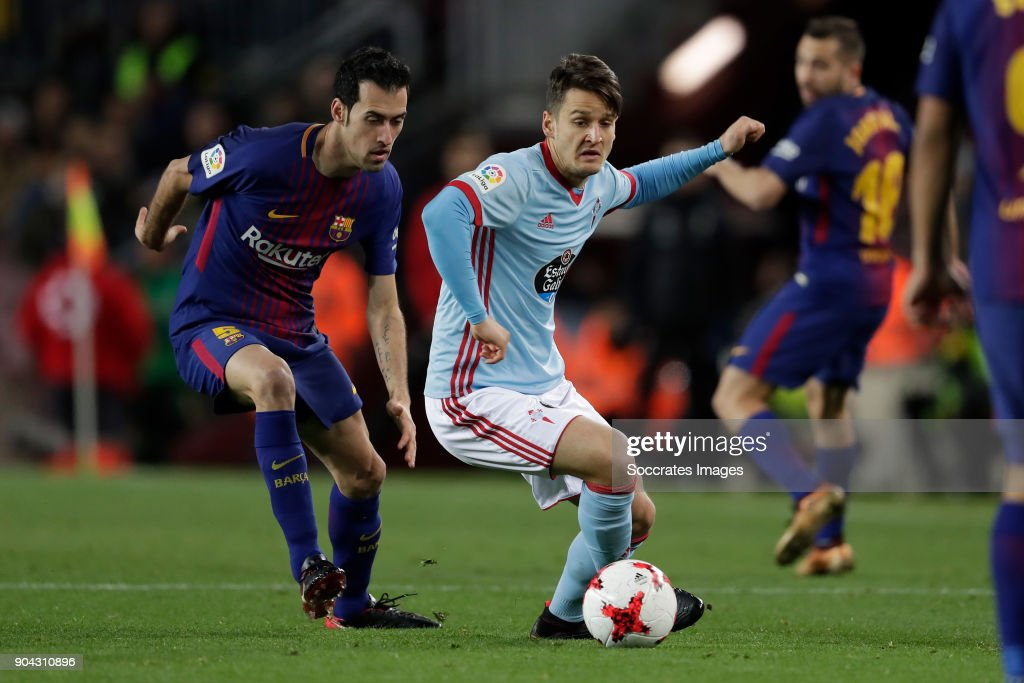 Sergio Busquets of FC Barcelona, Nemanja Radoja of Celta de Vigo during the Spanish Copa del Rey match between FC Barcelona v Celta de Vigo at the Camp Nou on January 11, 2018 in Barcelona Spain