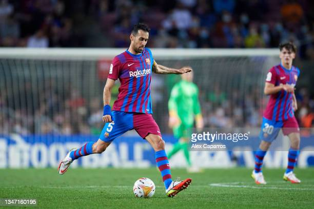 Sergio Busquets of FC Barcelona passes the ball during the LaLiga Santander match between FC Barcelona and Valencia CF at Camp Nou on October 17,...
