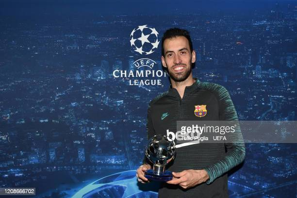 Sergio Busquets of FC Barcelona pose with the Man of the match trophy following the UEFA Champions League round of 16 first leg match between SSC...