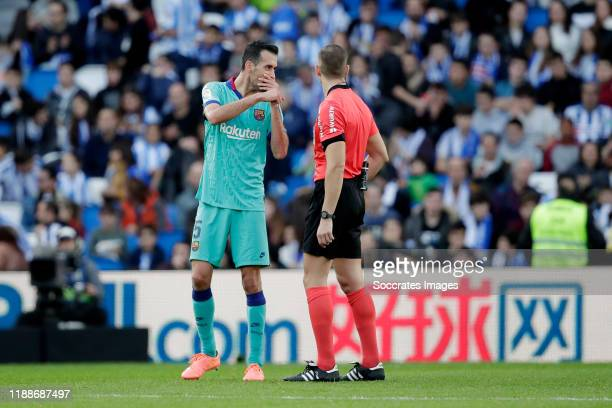 Sergio Busquets of FC Barcelona Referee Antonio Alberola Rojas during the La Liga Santander match between Real Sociedad v FC Barcelona at the Estadio...