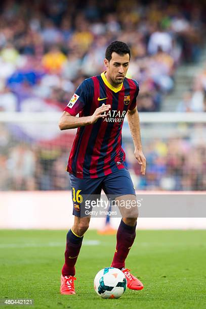 Sergio Busquets of FC Barcelona runs with the ball during the La Liga match between FC Barcelona and CA Osasuna at Camp Nou on March 16 2014 in...