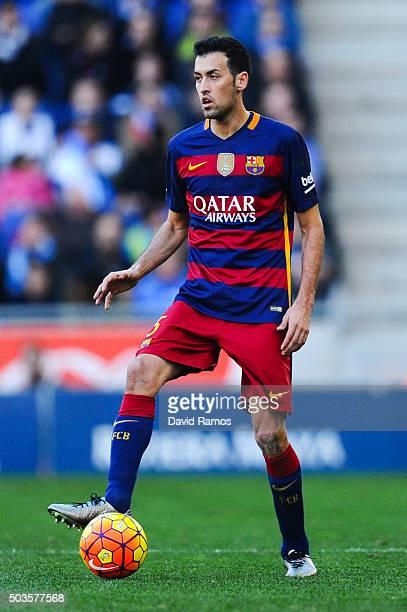 Sergio Busquets of FC Barcelona runs with the ball during the La Liga match between RCD Espanyol and FC Barcelona at CornellaEl Prat Stadium on...