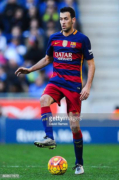 Sergio Busquets of FC Barcelona runs with the ball during the La Liga match between RCD Espanyol and FC Barcelona at CornellaEl Prat Stadium on...