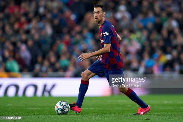 Sergio Busquets of FC Barcelona runs with the ball during the Liga match between Real Madrid CF and FC Barcelona at Estadio Santiago Bernabeu on...