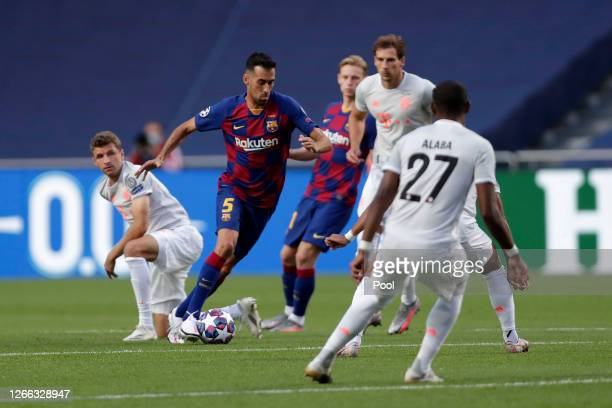 Sergio Busquets of FC Barcelona takes on David Alaba of FC Bayern Munich during the UEFA Champions League Quarter Final match between Barcelona and...