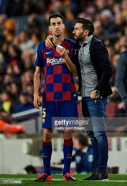 Sergio Busquets of FC Barcelona talks with his assistant Eder Sarabia during the Liga match between FC Barcelona and Real Sociedad at Camp Nou on...