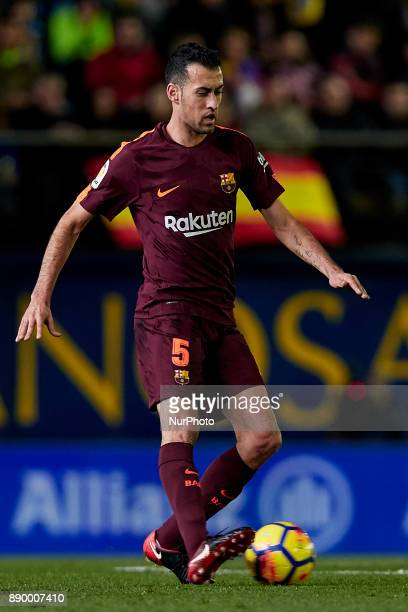 Sergio Busquets of FC Barcelona with the ball during the La Liga game between Villarreal CF and FC Barcelona at Estadio de la Ceramica on December 10...