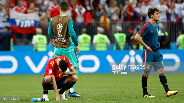 Sergio Busquets of Spain and Alvaro Odriozola of Spain look dejected after the 2018 FIFA World Cup Russia match between Spain and Russia at Luzhniki...