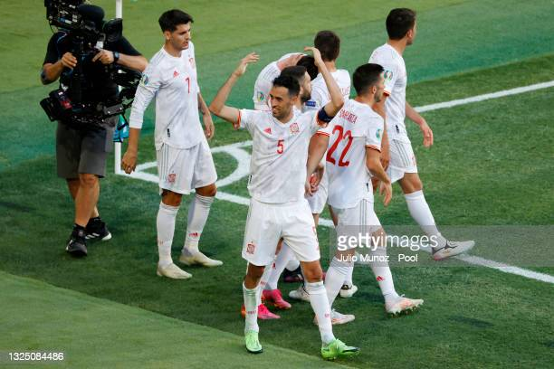 Sergio Busquets of Spain celebrates their side's second goal scored by team mate Aymeric Laporte during the UEFA Euro 2020 Championship Group E match...