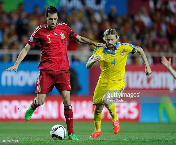 Sergio Busquets of Spain controls the ball beside Anatoliy Tymoshchuk of Ukraine during the Spain v Ukraine EURO 2016 Qualifier at Estadio Ramon...
