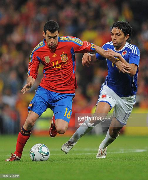 Sergio Busquets of Spain is challenged by Abel Aguilar of Colombia during the International friendly match between Spain and Colombia at Estadio...