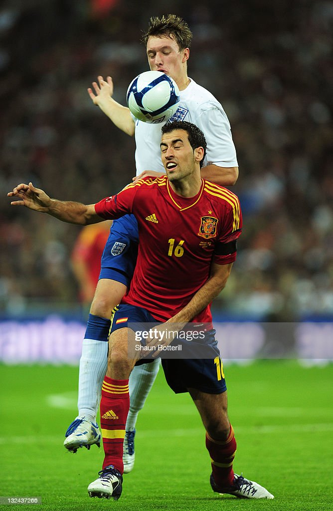 Sergio Busquets of Spain is challenged by Phil Jones of England during the international friendly match between England and Spain at Wembley Stadium on November 12, 2011 in London, England.