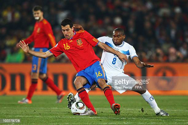 Sergio Busquets of Spain is challenged by Wilson Palacios of Honduras during the 2010 FIFA World Cup South Africa Group H match between Spain and...