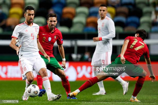 Sergio Busquets of Spain Joao Moutinho of Portugal Francisco Trincao of Portugal during the International Friendly match between Portugal v Spain at...