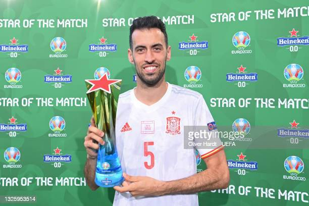 """Sergio Busquets of Spain poses for a photograph with the Heineken """"Star of the Match"""" award after the UEFA Euro 2020 Championship Round of 16 match..."""