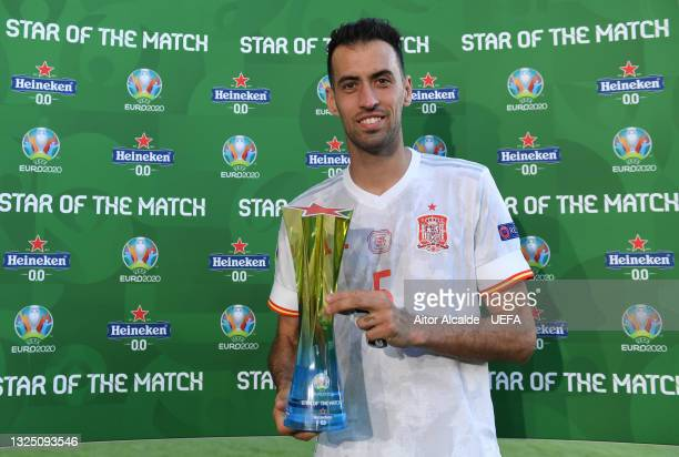 """Sergio Busquets of Spain poses for a photograph with their Heineken """"Star of the Match"""" award after the UEFA Euro 2020 Championship Group E match..."""