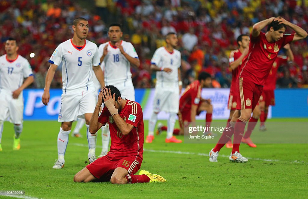 Sergio Busquets of Spain reacts after a missed chance during the 2014 FIFA World Cup Brazil Group B match between Spain and Chile at Maracana on June 18, 2014 in Rio de Janeiro, Brazil.
