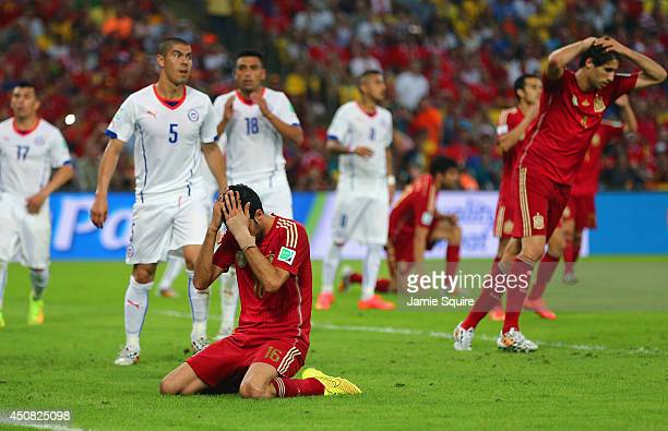 Sergio Busquets of Spain reacts after a missed chance during the 2014 FIFA World Cup Brazil Group B match between Spain and Chile at Maracana on June...