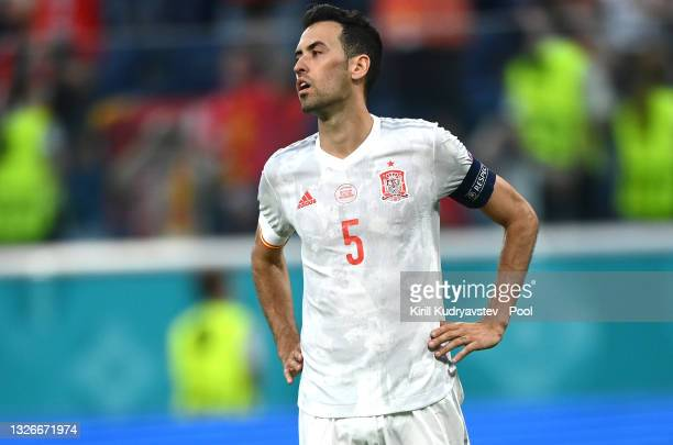 Sergio Busquets of Spain reacts after hitting the post from their side's first penalty in a penalty shoot out during the UEFA Euro 2020 Championship...