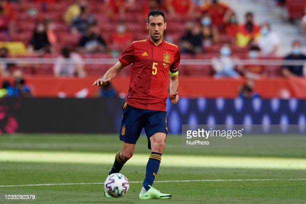 Sergio Busquets of Spain runs with the ball during the international friendly match between Spain and Portugal at Estadio Wanda Metropolitano on June...