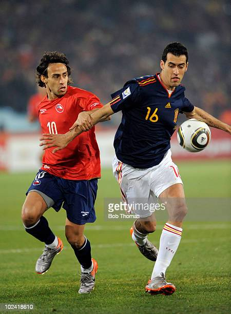 Sergio Busquets of Spain shields the ball from Jorge Valdivia of Chile during the 2010 FIFA World Cup South Africa Group H match between Chile and...
