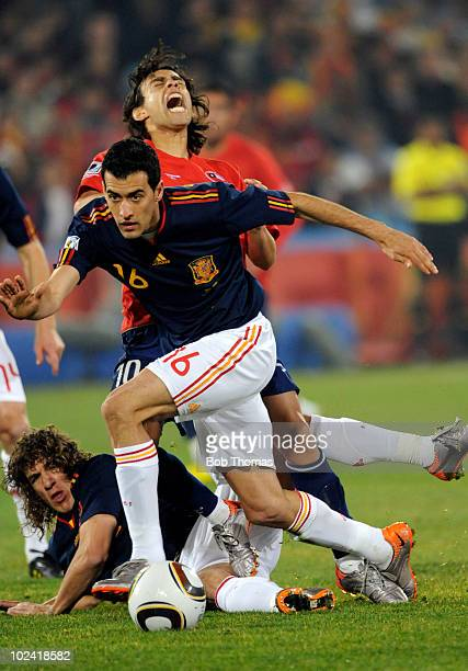 Sergio Busquets of Spain takes the ball from Jorge Valdivia of Chile during the 2010 FIFA World Cup South Africa Group H match between Chile and...