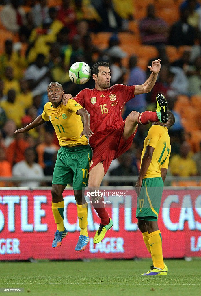 Sergio Busquets of Spain wins the header during the International friendly match between South Africa and Spain at Soccer City Stadium on November 19, 2013 in Johannesburg, South Africa.