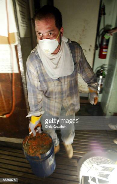 Sergio Cabrera removes spoiled and rotting food from the refrigerators at Tujaques restaurant in the French Quarter during cleanup after Hurricane...