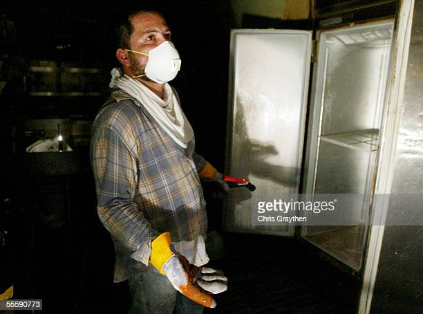 Sergio Cabrera talks about the smell inside Tujaques restaurant in the French Quarter as he cleans spoiled and rotting food out of the refrigerators...