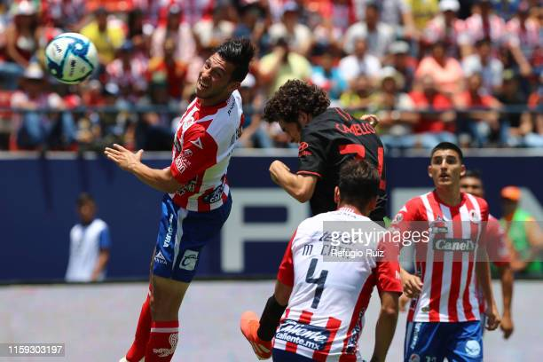 Sergio Camello of Atletico de Madrid heads the ball to score the first goal of his team during the friendly match between Atletico San Luis and...