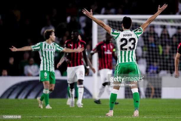 Sergio Canales of Real Betis Aissa Mandi of Real Betis during the UEFA Europa League match between Real Betis Sevilla v AC Milan at the Estadio...