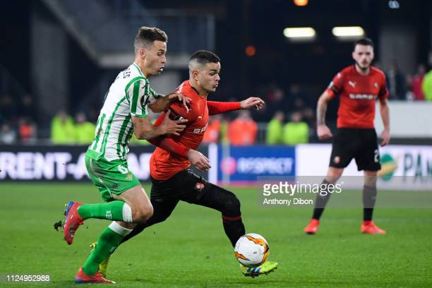 Sergio Canales of Real Betis and Hatem Ben Arfa of Rennes during the UEFA Europa League Round of 32 First Leg match between Rennes and Real Betis at...