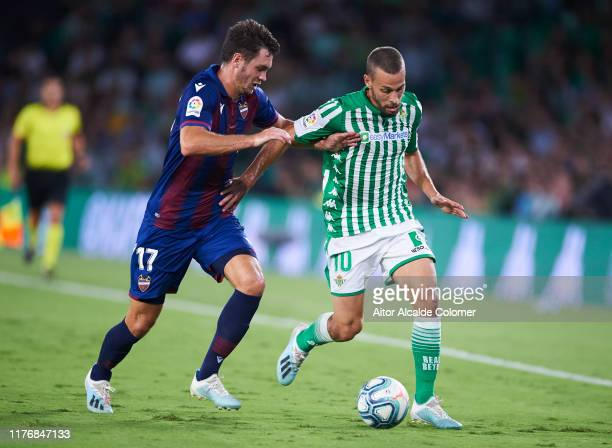 Sergio Canales of Real Betis Balompie duels for the ball with Nikola Vukcevic of Levante UD during the Liga match between Real Betis Balompie and...