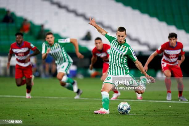 Sergio Canales of Real Betis Balompie scores a penalty to equalize during the Liga match between Real Betis Balompie and Granada CF at Estadio Benito...