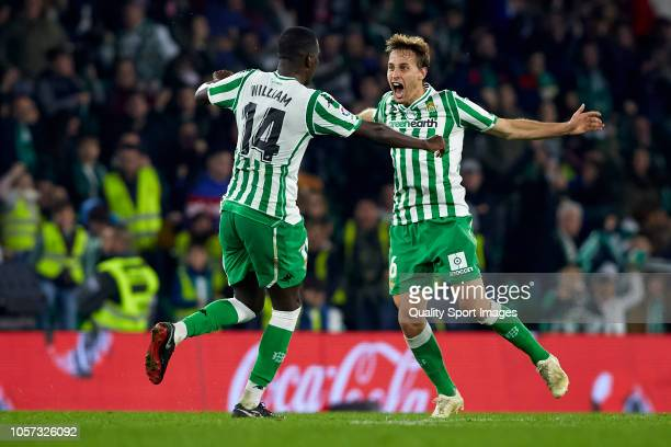 Sergio Canales of Real Betis celebrates after scoring his team's third goal with his teammate William Carvalho during the La Liga match between Real...