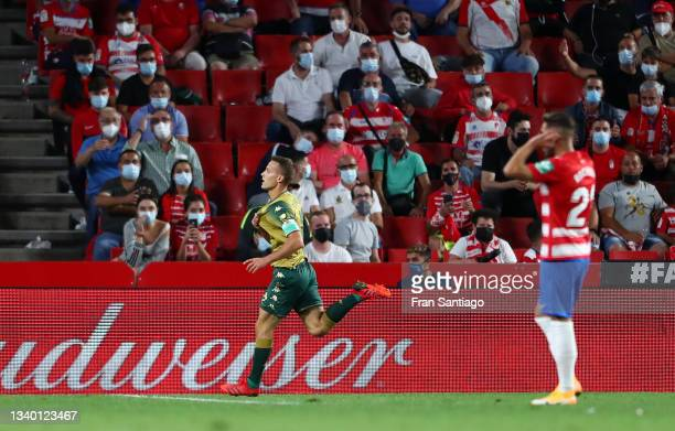 Sergio Canales of Real Betis celebrates after scoring their team's second goal during the LaLiga Santander match between Granada CF and Real Betis at...