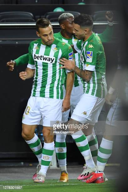 Sergio Canales of Real Betis celebrates with teammates after scoring his team's first goal during the La Liga Santander match between Valencia CF and...