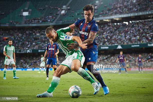 Sergio Canales of Real Betis competes for the ball with Tono Garcia of Levante UD during the Liga match between Real Betis Balompie and Levante UD at...