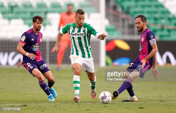 Sergio Canales of Real Betis is challenged by Luis Perez of Real Valladolid and Michel Herrero of Real Valladolid during the La Liga Santander match...
